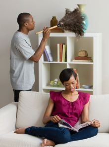 A Man Dusting and a Woman Relaxing