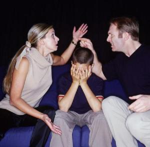 fighting couple with boy